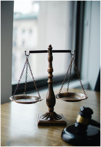 A gavel and a set of scales