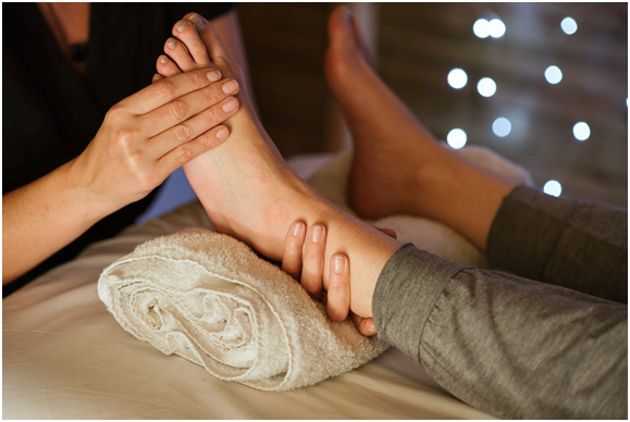 A reflexology massage in progress