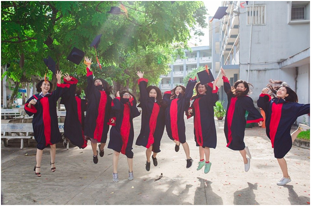 A group of friends jumping with joy on their graduation