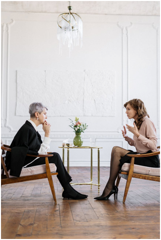 Woman discussing her problems with a therapist